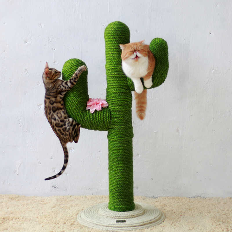 Two cats hanging from a cactus-shaped scratching post