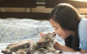 A girl cuddling with her cat